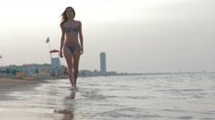 Slow-motion panorama of beautiful caucasian girl legs at sand beach Stock Footage