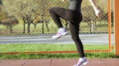 Woman athlete doing running raising the knees high Stock Footage