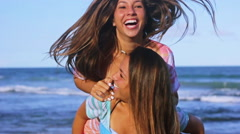Happy Summer Twins Jumping On Friends Back Lifestyle At The Beach In Slow Motion Stock Footage