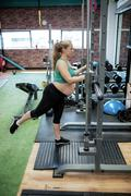 Pregnant woman exercising with fitness bar Kuvituskuvat