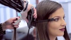 Hairdresser makes curls smiling girl Stock Footage
