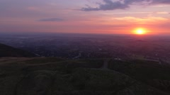 Wide orbiting aerial view of the Malvern Hills at sunrise. Stock Footage