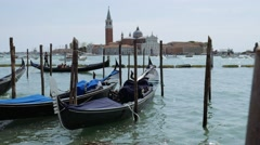 Gondolas from Piazza San Marco with San Giorgio Maggiore in the background Stock Footage