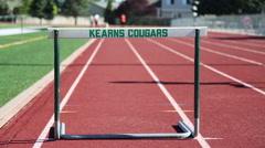Kearns Cougars hurdle runner Stock Footage