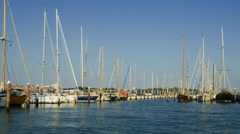 Marina with yachts reflecting in blue waters of Venice canal Stock Footage