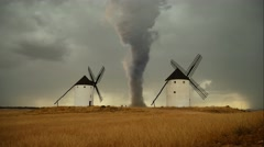 Massive devastating Tornado in a rural landscape with windmills Stock Footage
