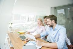 Smart employees are working in cooperation Stock Photos