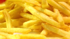 Adding tomato ketchup to french fries. Popular fast food, deep fried potato Stock Footage