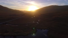 Stunning low aerial shot of sunrise over a stream in Snowdonia, Wales. Stock Footage