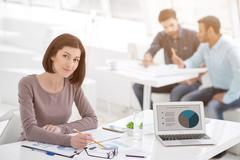 Successful businesswoman and business team at office meeting Stock Photos