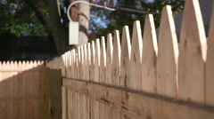 Lowering From Fence Tips to Grass on New Fence Stock Footage