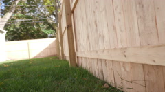 Low Angle Tilted Move Backward and Forward Side of New Fence Stock Footage