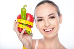 Happy girl dieting with healthy food Stock Photos