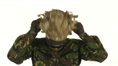 Soldier wears a helmet on his head. White backgraund Stock Footage