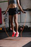 Woman exercising with skipping rope Stock Photos