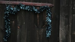 Decorative chain hanging on old wooden door. Stock Footage