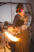 Welder welding a metal Kuvituskuvat