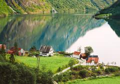 View Of Scandinavian Houses In Norwegian Village On Shore Of The Stock Photos