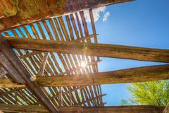 Sunrays Through Wooden Destroyed Roof Of Abandoned House In Exclusion Stock Photos