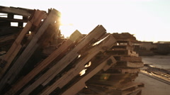 A Stack of Pallet with Sun Setting in Distance Stock Footage