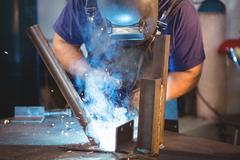 Welder welding a metal Stock Photos