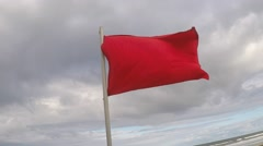 Red Warning Flag at the Beach Stock Footage