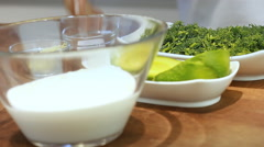 Yogurt soup in colors mixing with mixer dill avocado  Stock Footage