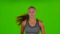 Female runner with a slender figure is running. Front view. Green screen Stock Footage