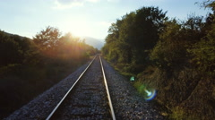 Beautiful countryside scenery railroad aerial drone motion railway sunshine sky Stock Footage