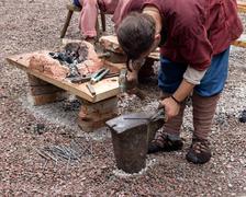 Blacksmith forges metal Stock Photos