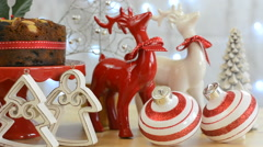 Festive Christmas food table with fruit cake and reindeer ornaments Stock Footage