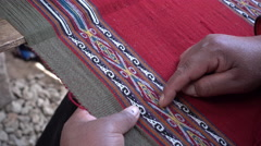 Pointing At Woven Inca Design Stock Footage