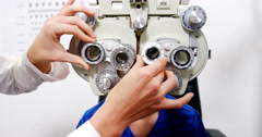 Female optometrist examining young patient on chiropter Stock Footage