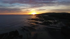 Fast moving aerial view of the Somerset coast at sunrise. Stock Footage