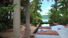 Women receiving a massage at a Luxurious villa on the beach in St John Stock Footage