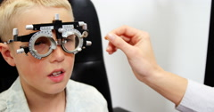 Optometrist examining young patient with chiropter Stock Footage