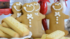 Festive Christmas food table with gingerbread men and cake. Stock Footage