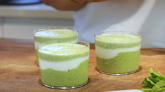 Cucumber yogurt soup colors mint dill plating and serving Stock Footage