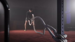 Adult athlete doing exercise with rope Stock Footage