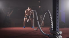 Young athlete doing exercise with rope Stock Footage