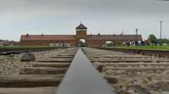 4K Low Down POV, Gate of Death, Auschwitz Camp Entrance Stock Footage