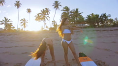 Two Beautiful Surf Girls Revealed Stretching At The Beach In Slow Motion Stock Footage