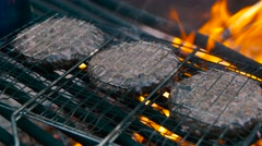 Grilling Burgers Over Open Fire Stock Footage