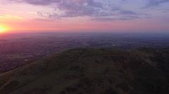 Slow wide aerial orbit of the Malvern Hills at sunrise. Stock Footage