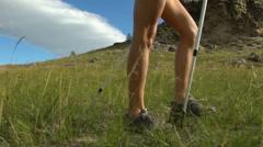 Hiking woman tourist is walking mountain range Stock Footage