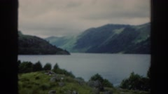 1961: a tranquil lake surrounded by hills and trees SCOTLAND Stock Footage