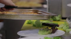 Cooking meat, potatoes and salad in the kitchen Stock Footage