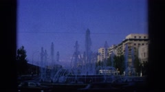1966: public fountain in a busy city. SPAIN Stock Footage