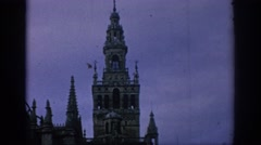 1966: view of a castle and tower in a european location surrounded by an ornate Stock Footage