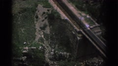 1966: aerial view of land with long rail running through grass land SPAIN Stock Footage